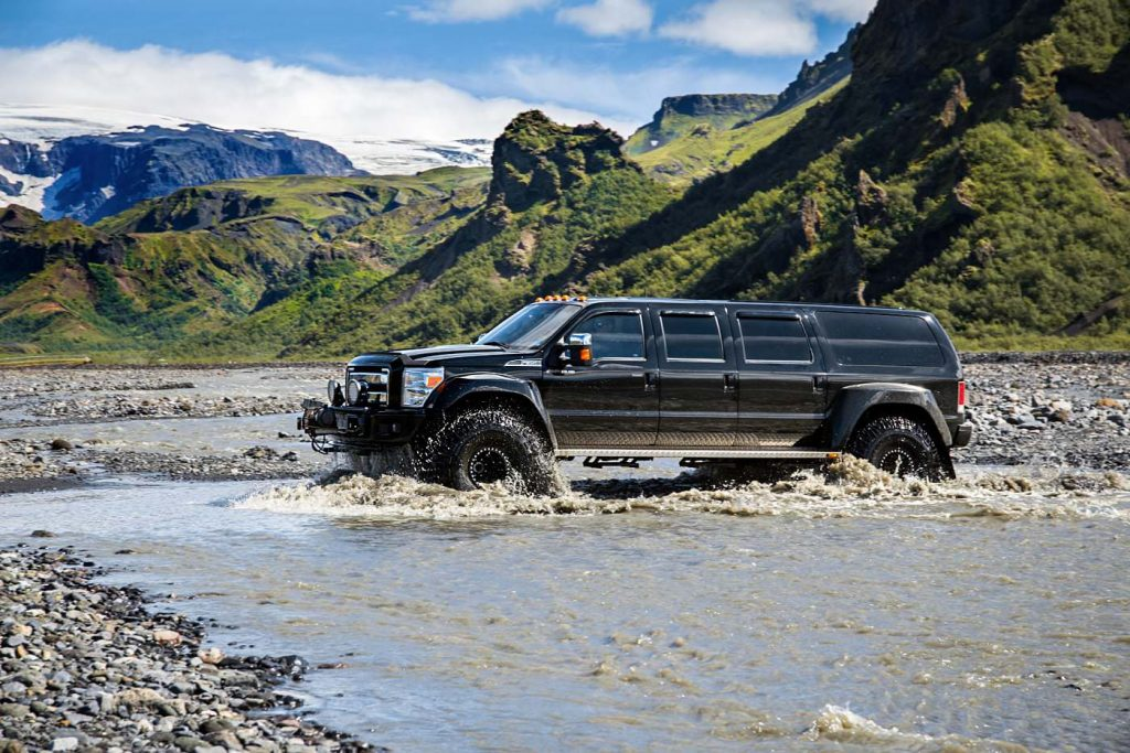 Super Jeep crossing a river, Thorsmork, South Iceland
