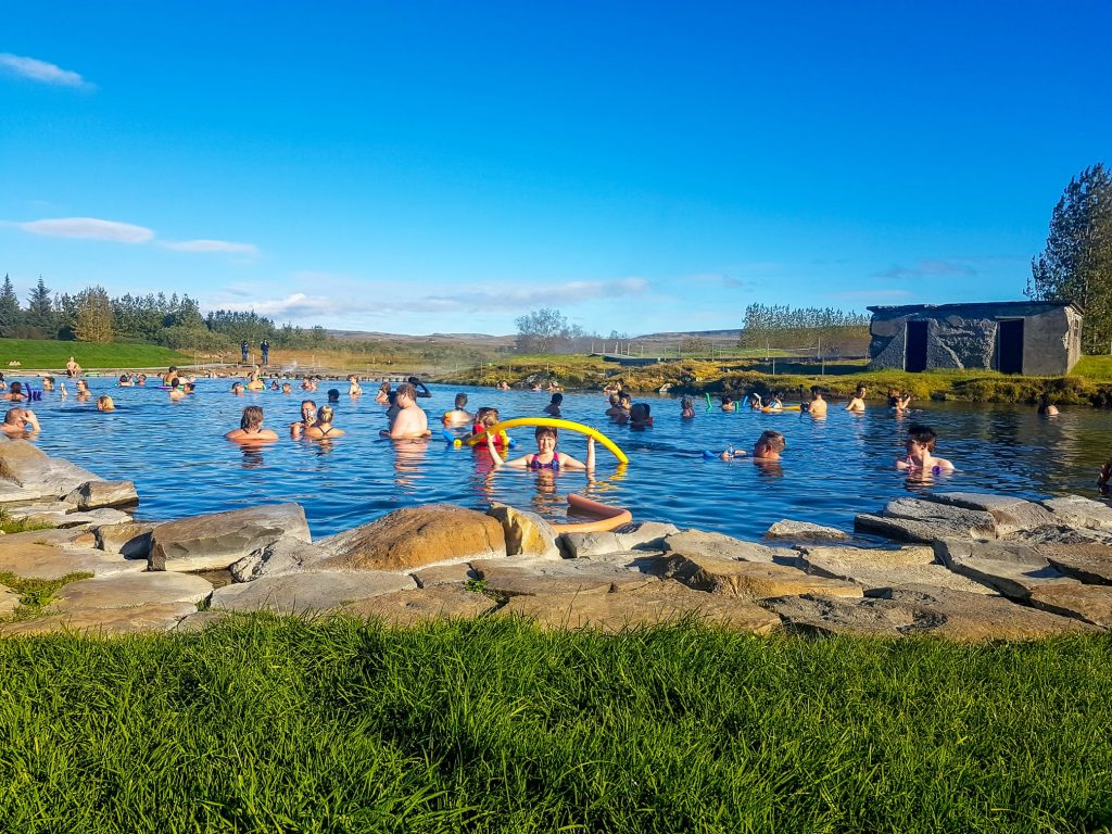 Secret lagoon geothermal bath full of travelers