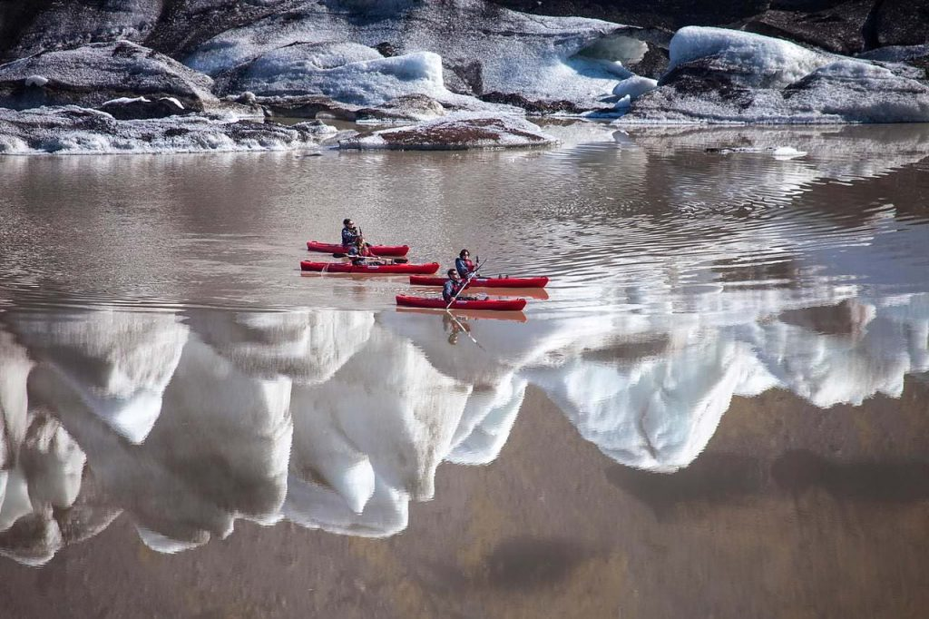 Kayaking in a glacier lagoon by Solheimajokull